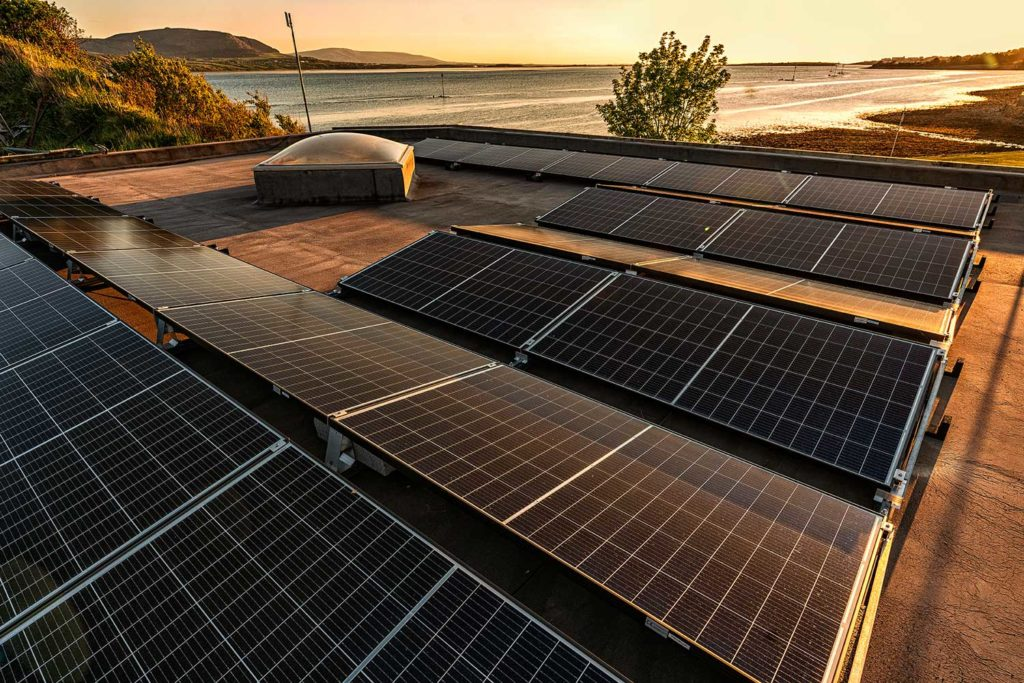 Solar panels on roof at sunset